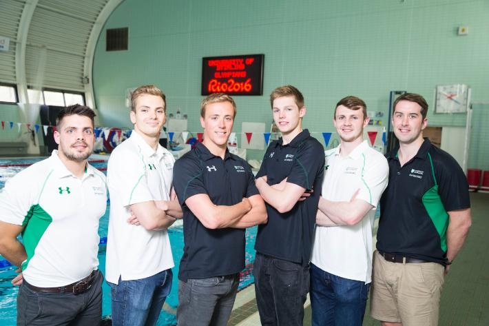 Swimmers and coaches-710x473